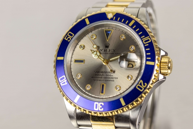Rolex Perpetual Date Submariner Gold Navy